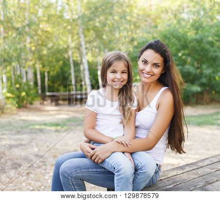 Portrait of a mother and daughter in the summer park