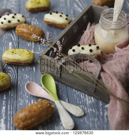 Eclairs with chocolate and whipped cream on dark background. Traditional French dessert.
