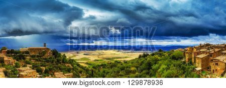 Montalcino, old historic medieval town, Italy. Tuscan landscape in the background - panorama