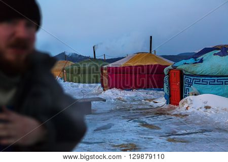 Baikal, Russia - March 08, 2016: Seasonal village of yurts for fishermen on the ice in the Lake Baikal.