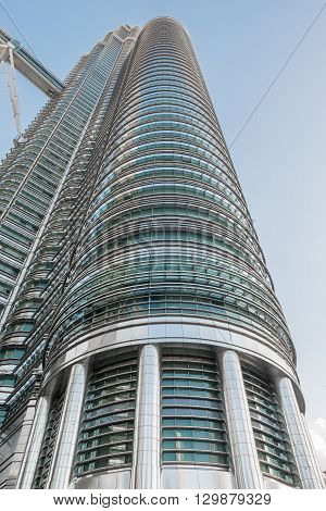 KUALA LUMPUR MALAYSIA - FEBRUARY 29: One of Petronas twin towers on February 29 2016 in Kuala Lumpur Malaysia. Architectural details of the Petronas Towers.