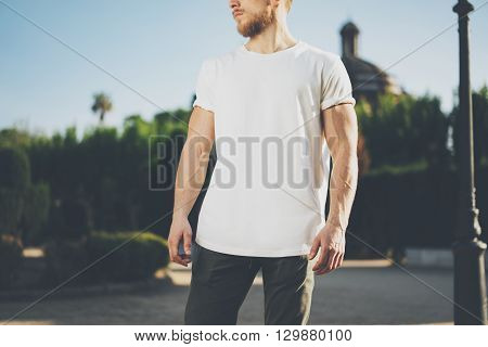 Photo Bearded Muscular Man Wearing White Blank t-shirt. Green Garden Outdoor Background. Blurred. Horizontal Mockup.