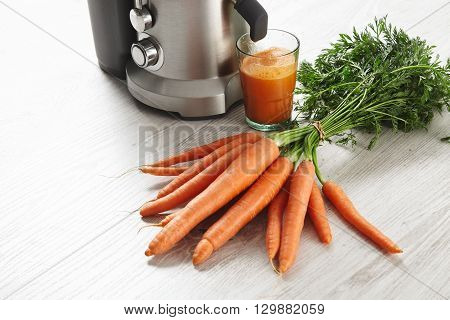 Close View Metallic Professional Juicer With Glass Ifilled With Tasty Juice For Breakfast From Organ
