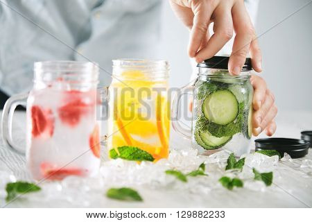 Bartender Closes One Jar With Cold Fresh Beverage With Black Cap Preparation Of Homemade Tasty Lemon