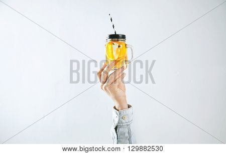 Men Hand Presents Homemade Cold Lemonade From Oranges, Sparkling Water And Ice Cubes Isolated On Whi