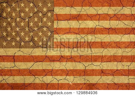 American flag and dry earth surface background