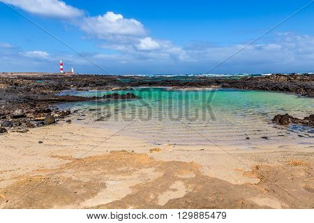 Toston Lighthouse And Rocky Seashore - El Cotillo Fuerteventura Canary Islands Spain