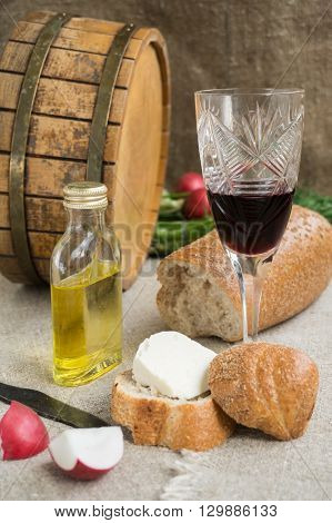 Octave wineglass oil bread and cheese are on sacking