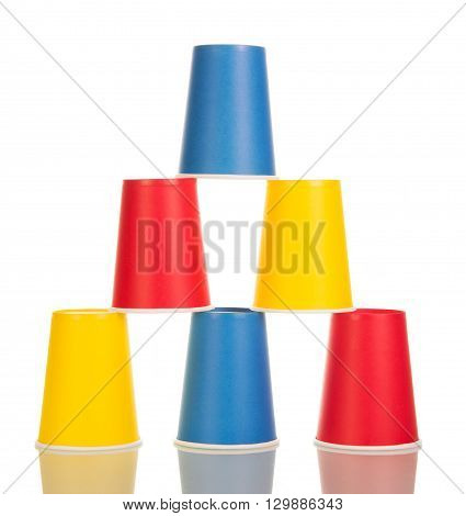 Multi-colored disposable paper cups isolated on white background.