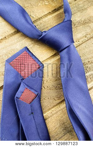 tie on a wooden background close up