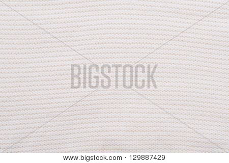 Close up of beautiful wrinkle ivory fabric texture.