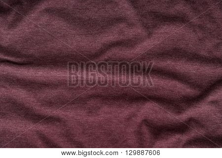 Close up of beautiful wrinkle burgundy fabric texture.