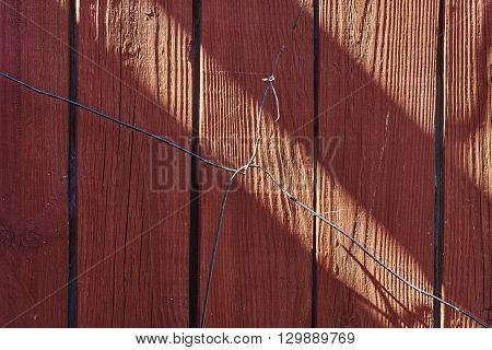 wire junction on red wood wall. wood texture.