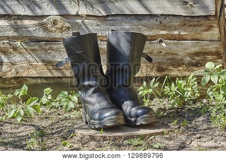 Old black leather russian boots close up