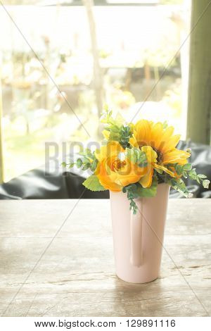 Vase of flowers on table.  Artificial Flower Vase