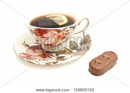 Tea With Lemon And Chocolate Bar On White