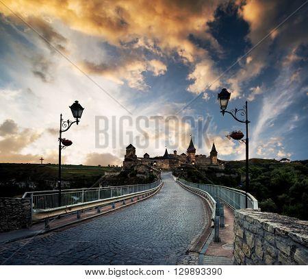 bridge road to Kamenetz-Podolsky fortress at dusk at sunset