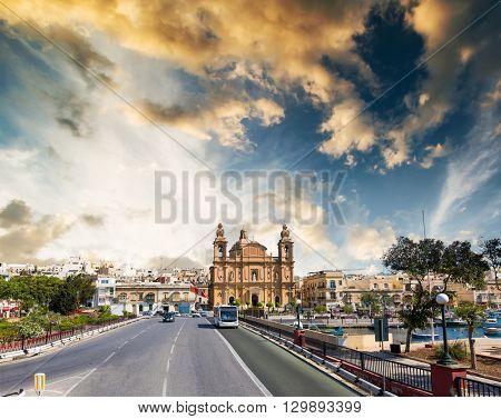 picturesque photo of Msida Parish Church in Valletta from Triq Marina road in Malta