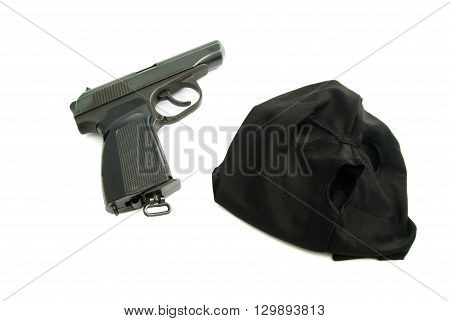 Mask And Gun On White