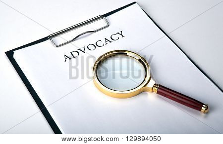 document with the title of advocacy with loupe close up