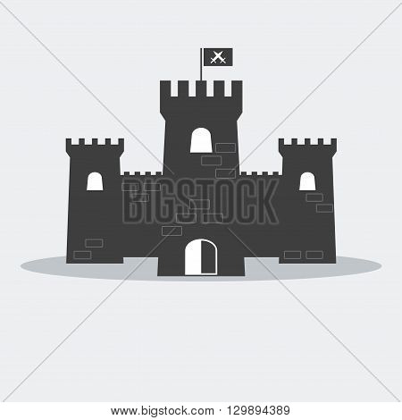 Medieval brick castle with towers and flag.