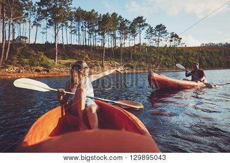 Young Couple Kayaking On The Lake