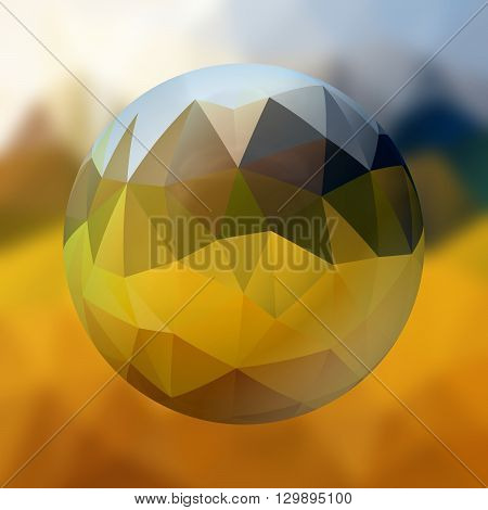 glass sphere with polygon pattern on blurred background - yellow and blue colored