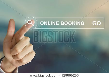 business hand clicking online booking button on search toolbar with vintage style effect