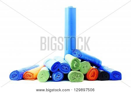 A lot of garbage bags rolls on a white background