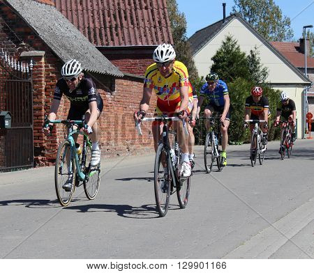 AALST, BELGIUM MAY 5 2016: Senior amateur riders from various cycle clubs compete in a bike race through the streets of Aalst, in East Flanders. Cycling is a very popular sport in Belgium.