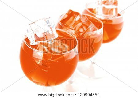 wine and transparent crystal ice on white