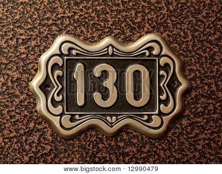 Close up shot of door with numerals 130.