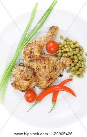 bbq : chicken ham garnished with green onion pens and red chili hot pepper on white plate isolated over white background
