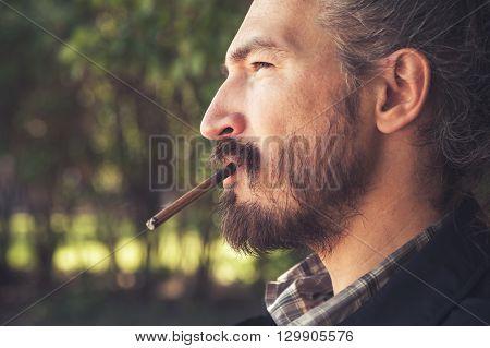 Man Smoking Cigar, Outdoor Profile Portrait