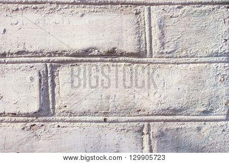 gray old brick masonry wall texture and background