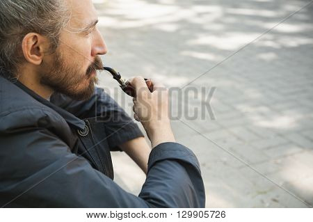 Bearded Man Smoking Pipe, Outdoor Portrait