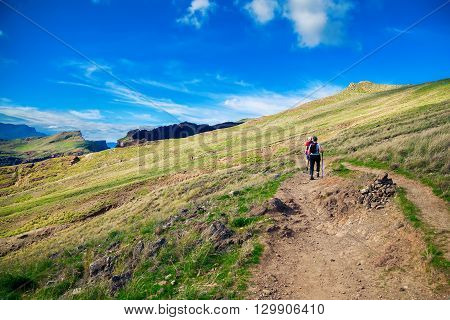 mature couple walking on the trekking path at Ponta de Sao Lourenco Madeira
