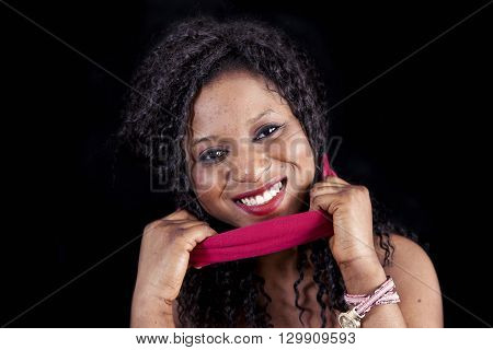 Portrait Of Young African American Female Takes Off Her Red Blindfold On