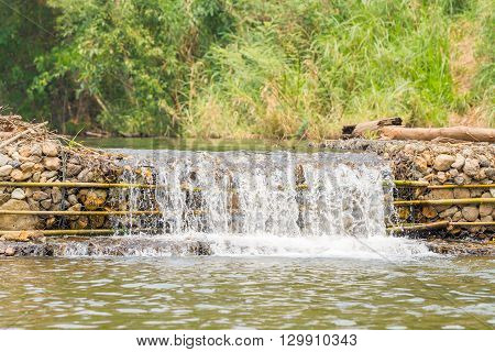 small weir irrigate in the Pai Thailand