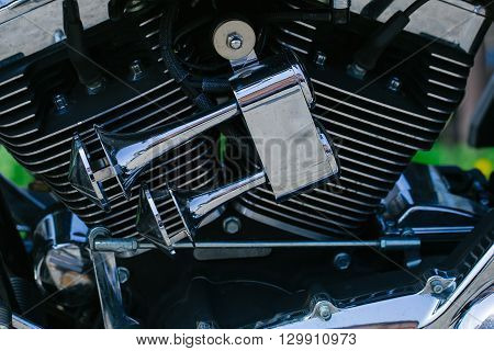 Close up of motorbikes chromed powerful engine