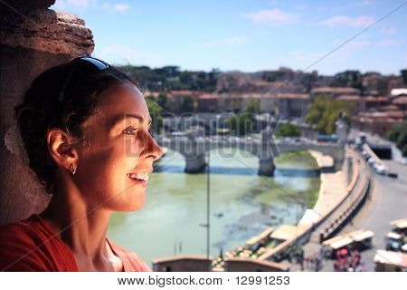Young beautiful woman near window in Sant' Angelo Castel. View of Rome from Sant' Angelo Castel in Rome, Italy
