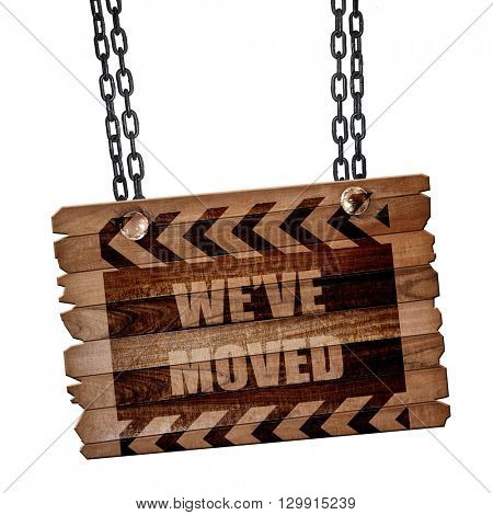 We've moved sign, 3D rendering, wooden board on a grunge chain