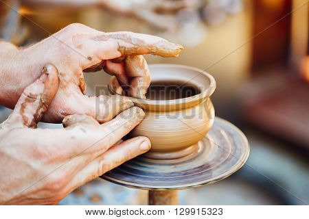 Process Of Creating A Clay Pot. Using Hands. Pottery Craft Wheel And Ceramic Clay Pot