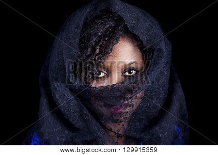 Portrait Of Young African American Female With A Black Veil On His Head