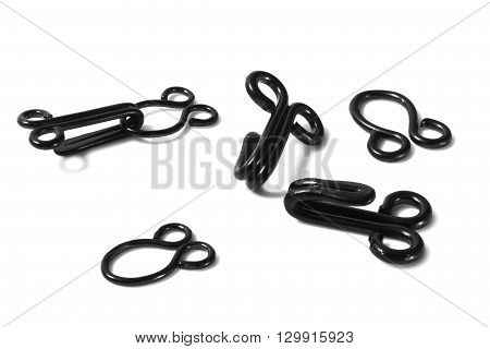 Macro of hook and eye closures on white background