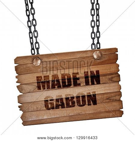 Made in gabon, 3D rendering, wooden board on a grunge chain
