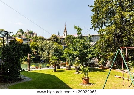 BADEN AARGAU SWITZERLAND - JUNE 30, 2015: Typical view from Wettingen side to the city of Baden and a playground on June 30 2015. Baden is a municipality in the Swiss canton of Aargau.