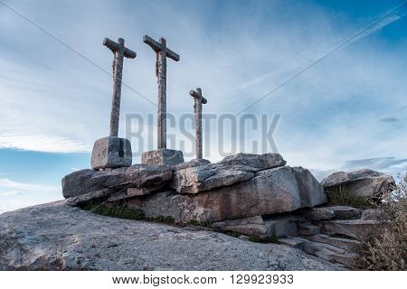 various waterway crossings on stone monolith with cloudy sky