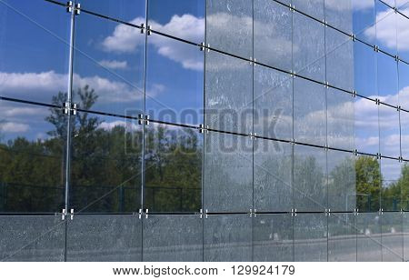 The surface of the walls decorated facade gray tiles and frosted tinted glass