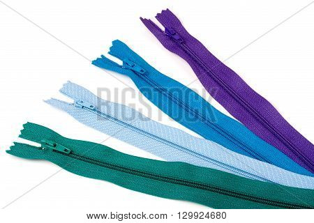 Four multi-colored zipper isolated on white background.